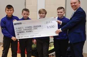 Cheque presentation by 4th Newotownabbey Juniors to PCI Moderatorv