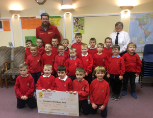 Anchor Boys in Northern Ireland present £11,000 cheque to Children's Heartbeat Trust.